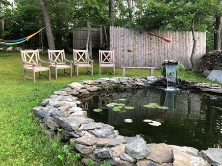 Wellfleet, Pleasant Point Cape Cod vacation rental - Koi Pond with seating and hammock, relaxation central!