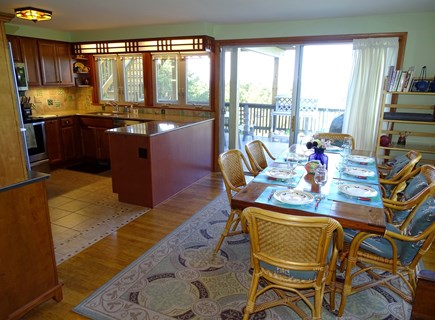 Truro Cape Cod vacation rental - Dining room and adjacent kitchen, sliders to deck