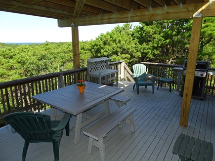Truro Cape Cod vacation rental - Middle deck area, off dining room, with grill and water views