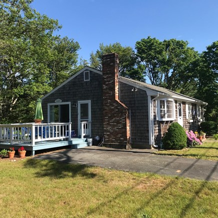 Dennis Port Cape Cod vacation rental - Sunny deck off the kitchen, overlooking conservation land in back