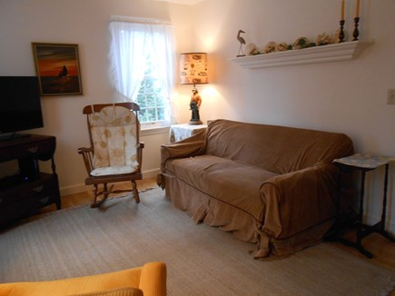 Dennis, Harwich Cape Cod vacation rental - Lounge room w/flat screen TV, sofa & chairs.