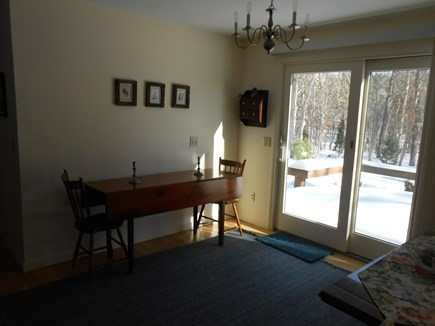 Dennis, Harwich Cape Cod vacation rental - Dining room table seats 6-8, leads to deck.