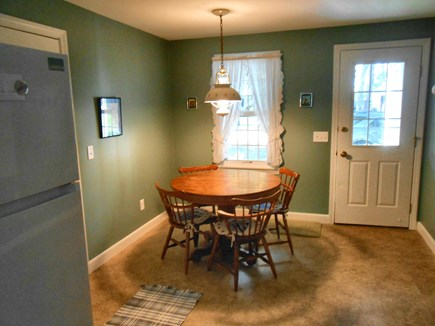Dennis, Harwich Cape Cod vacation rental - Kitchen w/open eating area, opens to LR, farmers porch & garage.