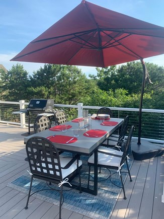 Eastham Cape Cod vacation rental - Outdoor dining on rebuilt and expanded deck (with grill).