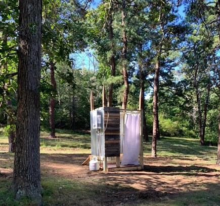 DENNIS Cape Cod vacation rental - Hot water shower just off the wooded path.