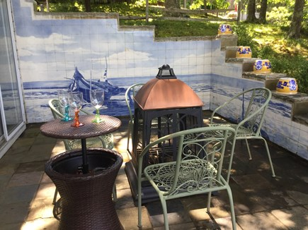 E Falmouth Cape Cod vacation rental - Patio with special order Portuguese tile mural by the pond