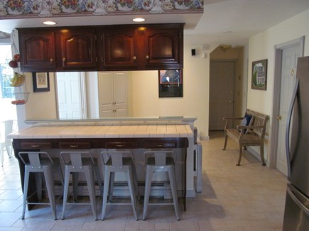 Chatham Cape Cod vacation rental - Open kitchen w/4 bar-stools, Music, TV sitting area, & sun-room.