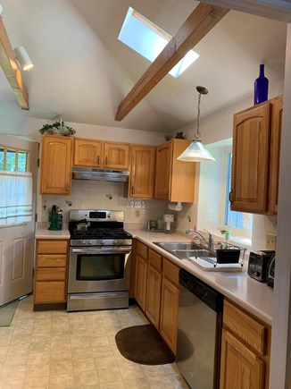 Plymouth, White Horse Beach, Manomet MA vacation rental - Modern kitchen with new fridge, dishwasher, gas stove & skylight