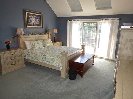 Yarmouth Cape Cod vacation rental - The master bedroom has as King bed and a private deck