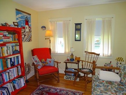 Hyannis Cape Cod vacation rental - Sitting room with books and futon couch