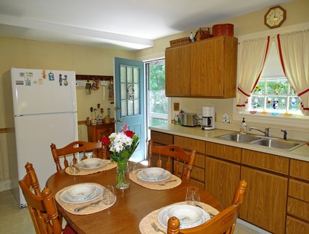 Hyannis Cape Cod vacation rental - Kitchen with door to backyard