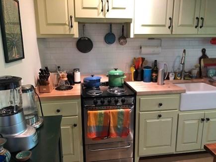 Wellfleet Cape Cod vacation rental - Eat-in kitchen with back door to small deck.