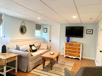 Brewster Cape Cod vacation rental - Basement bedroom seating area, tv and half bath