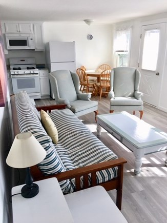 West Dennis Cape Cod vacation rental - Living room. Comfortable seating, large windows for ocean breeze.