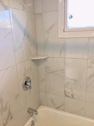 West Dennis Cape Cod vacation rental - Full tile bathroom with bright and sparkling marble-like tile
