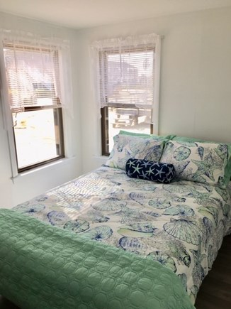 West Dennis Cape Cod vacation rental - Master bedroom with full bed , two windows and peak at the ocean.