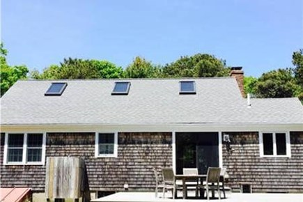 Orleans Cape Cod vacation rental - A classic Cape house with a large back deck and big yard.