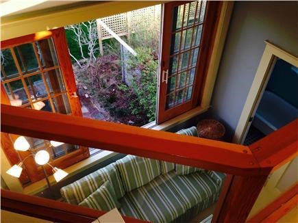 Truro Cape Cod vacation rental - Looking down from loft to sofa bed in common area