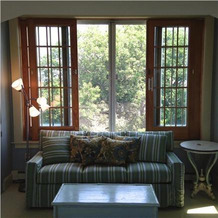 Truro Cape Cod vacation rental - Ten foot slider windows behind queen sofa bed, 2nd floor of barn