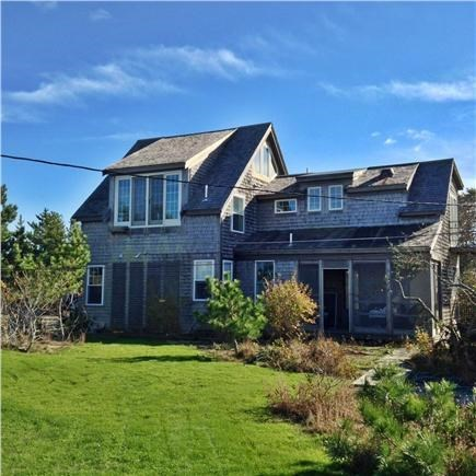 Truro Cape Cod vacation rental - View of cottage and attached barn from west lawn