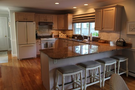 North Chatham Cape Cod vacation rental - Lovely kitchen with island and dining table