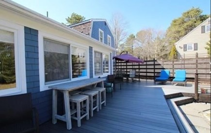 South Yarmouth Cape Cod vacation rental - Very large deck with sitting areas off of kitchen (main house)
