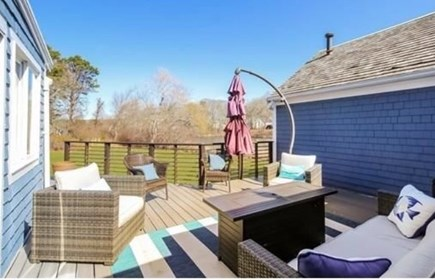 South Yarmouth Cape Cod vacation rental - Spacious deck with sitting area off of living room (in-law side)