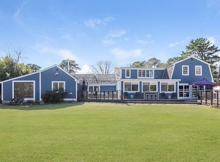 South Yarmouth Cape Cod vacation rental - Very large furnished deck with grille & great yard for kids