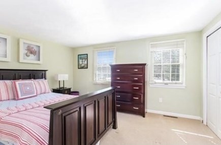 South Yarmouth Cape Cod vacation rental - Guest bedroom (main house - Queen bed & AC unit)