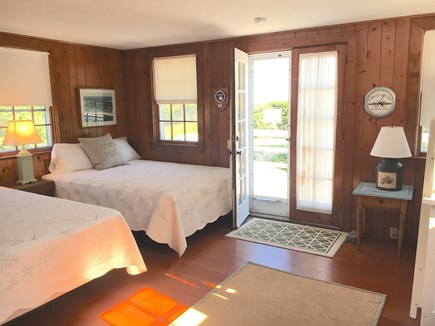 Harwich Port Cape Cod vacation rental - Crow's Nest has two queens, bunks, full bath and its own deck