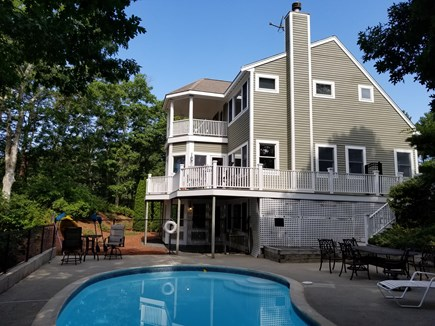 Mashpee, New Seabury area Cape Cod vacation rental - Pool side view of the home and extensive decks and patio