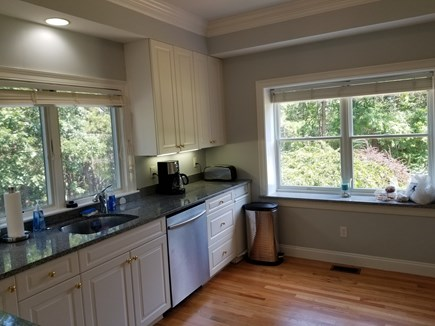 Mashpee, New Seabury area Cape Cod vacation rental - Kitchen with large windows and views of woods and private drive