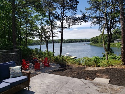 Mashpee, New Seabury area Cape Cod vacation rental - Rear view from patio on water and fire pit area