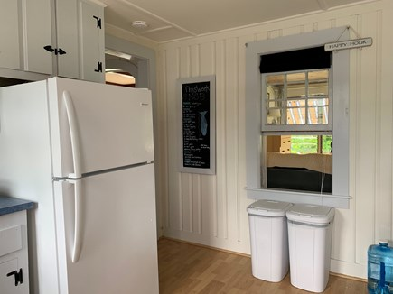 Falmouth, New Silver Beach Cape Cod vacation rental - Kitchen looking into the screened in porch