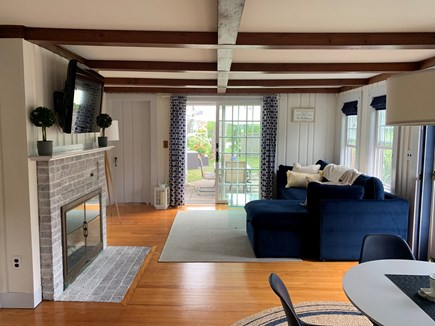Falmouth, New Silver Beach Cape Cod vacation rental - Open space, with fireplace, TV leading to outdoor dining set,
