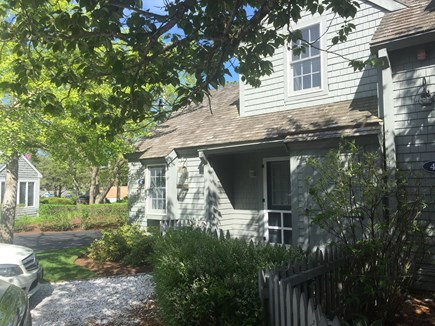 New Seabury, Mashpee New Seabury vacation rental - Shady front of condo cottage w/front patio & dedicated parking.
