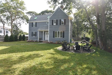 Harwich Port Cape Cod vacation rental - Sea Haus has a new lawn & fire pit elevating outdoor living!
