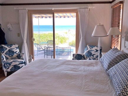 East Dennis, Walking distance  Cape Cod vacation rental - Master bedroom with king bed and sliding doors onto deck