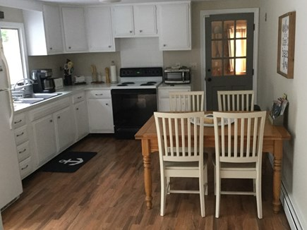 Barnstable, Hyannis Cape Cod vacation rental - Large kitchen, table expands to accommodate more people.
