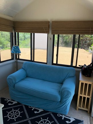 West Dennis Cape Cod vacation rental - Sunroom - Mounted TV, washer/dryer and Slider access to deck.