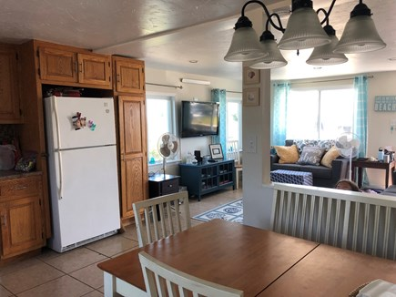 West Dennis Cape Cod vacation rental - Kitchen/Living room - seating for 6 at the table.