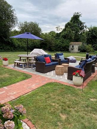 Dennis Cape Cod vacation rental - Beautiful bluestone and brick patio fully fenced backyard