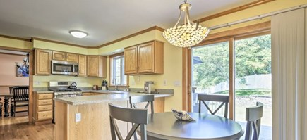 Onset MA vacation rental - Eat-in-kitchen with sliders to deck and large DR (sits 8-10)