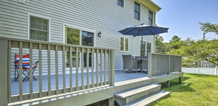 Onset MA vacation rental - Large yard with patio furniture & garden shower hose to wash off.