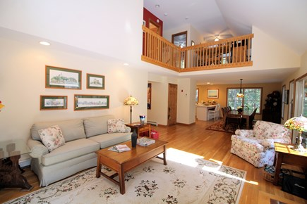 Wellfleet Cape Cod vacation rental - Open living area with dining area and kitchen beyond