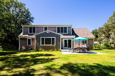 Chatham Cape Cod vacation rental - Large, private backyard with lawn and outdoor dining on the patio
