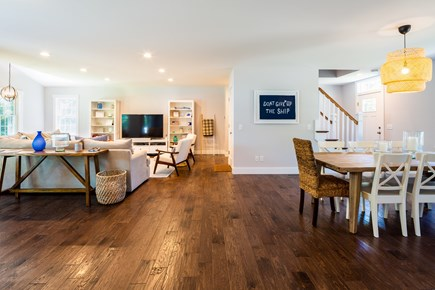 Chatham Cape Cod vacation rental - Great room with living and dining. Beautiful hardwood flooring.
