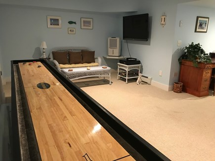 East Harwich Cape Cod vacation rental - Shuffleboard in finished basement