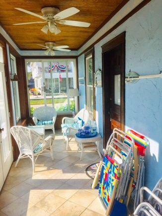 Falmouth Heights Cape Cod vacation rental - Enclosed sun porch w/3 ceiling fans & 10 beach chairs for use.