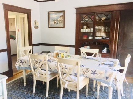 Falmouth Heights Cape Cod vacation rental - Dining room w/ seating for 8 opens to large sliders to deck.